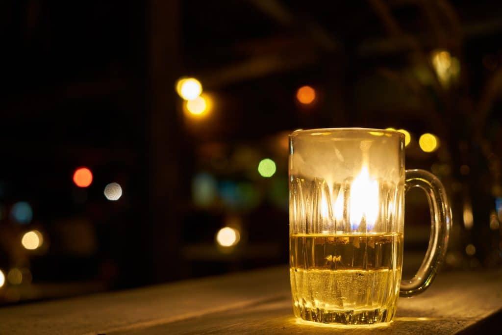 cup of beer on a bar - the prisoner