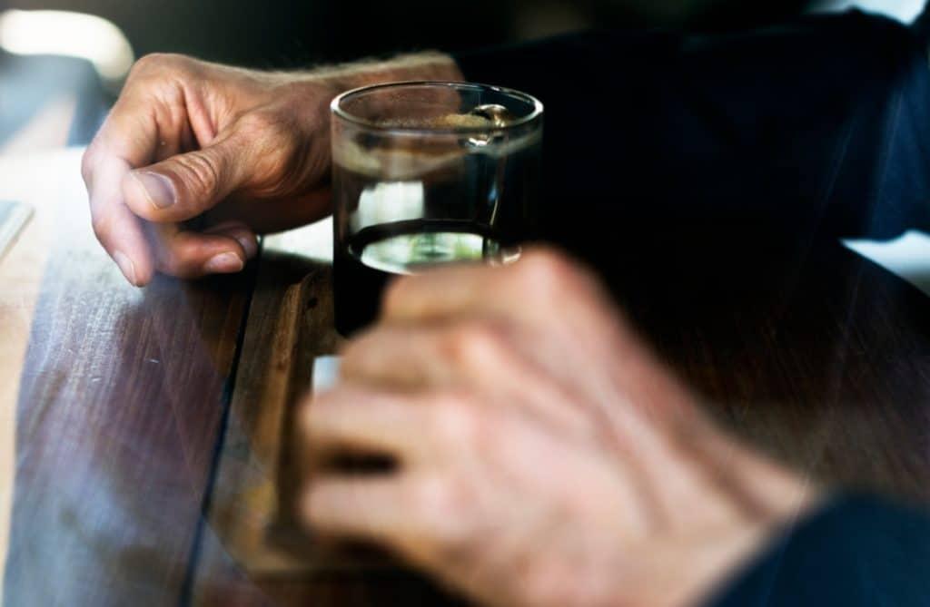 Hands drinking tabletop
