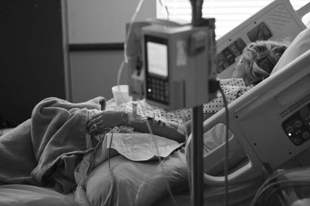 woman in hospital bed, vacuum extraction