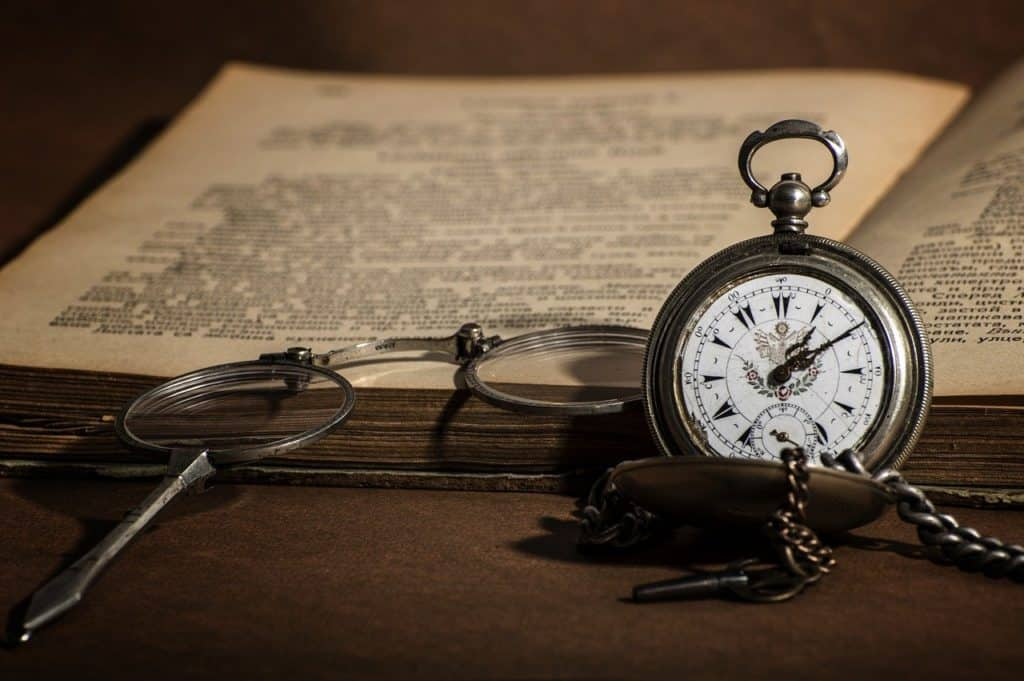 Watch, old book, spectacles